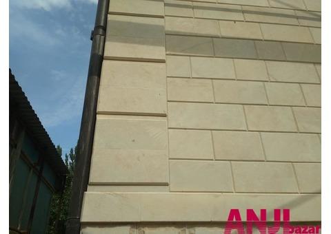 Услуги по облицовке фасада камнем